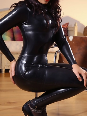 """Kinky brunette unzips her tight black catsuit to reveal her hot body in lemon lingerie."""